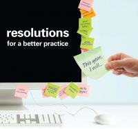computer monitor with sticky notes of new years resolutions