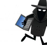 sinister man stealing laptop