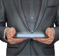 man holding tablet