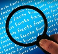magnifying glass over words facts