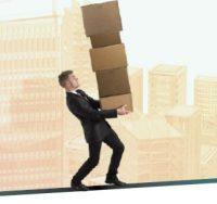 man balancing boxes